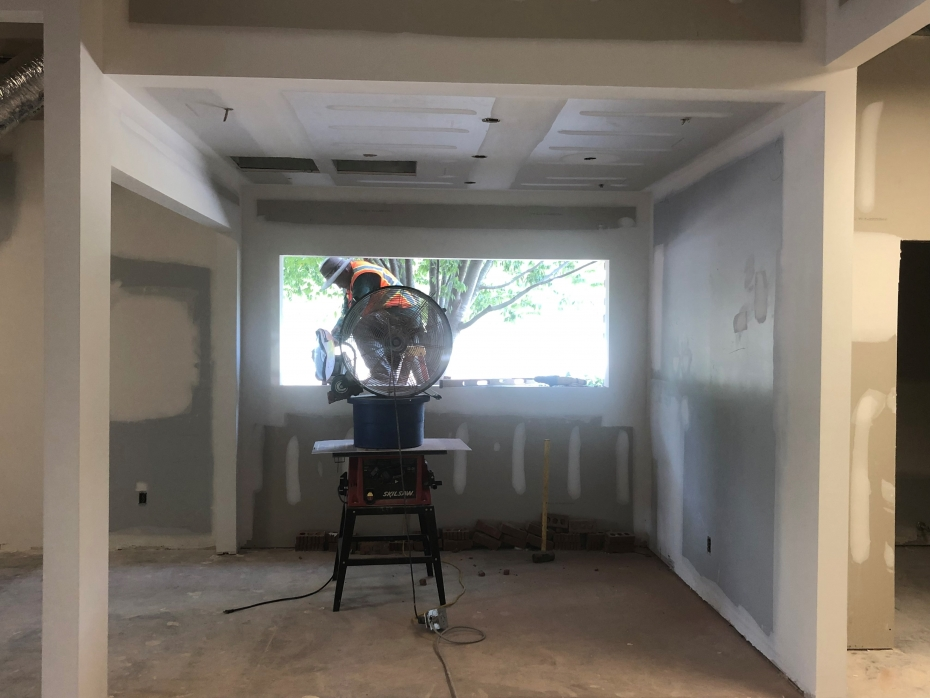 Photo of a construction worker framing a window at Richland Library Lower Richland.